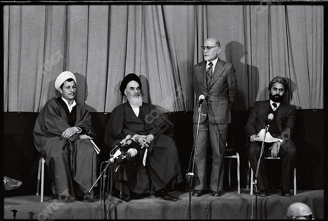 (l to r): Akbar Hashemi Rafsanjani, Ayatollah Khomeini, Mehdi.Bazargan, and an interpreter at a press conference at the Refah School announcing Bazargan's appointment as prime minister. Tehran, February 5, 1979