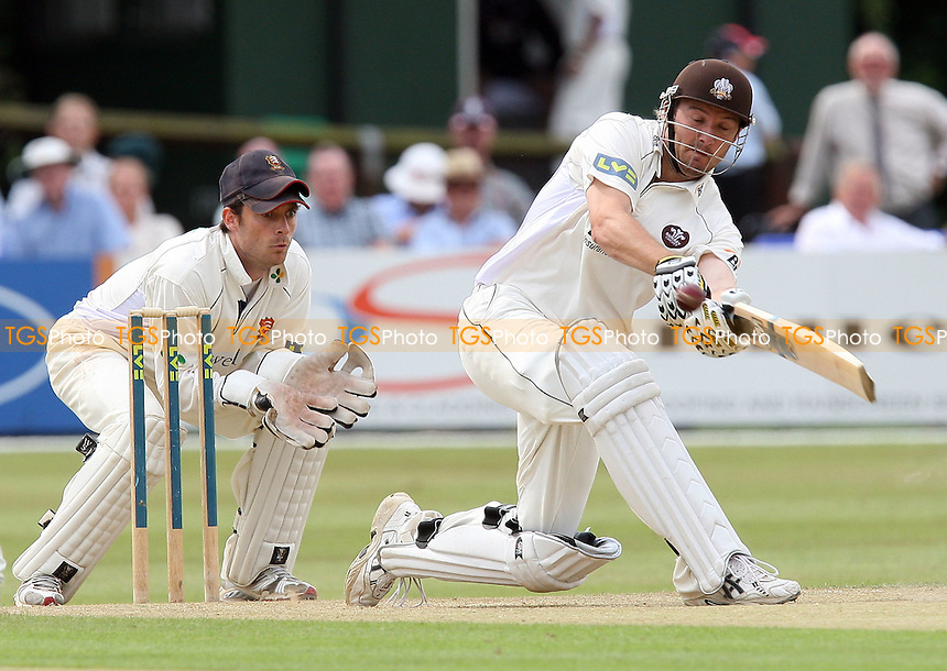 Century-maker Chris Schofield in batting action for Surrey as James Foster looks on from behind the stumps - Essex CCC vs Surrey CCC - LV County Championship Division Two Cricket at Castle Park, Colchester -  20/08/09 - MANDATORY CREDIT: Gavin Ellis/TGSPHOTO - Self billing applies where appropriate - Tel: 0845 094 6026