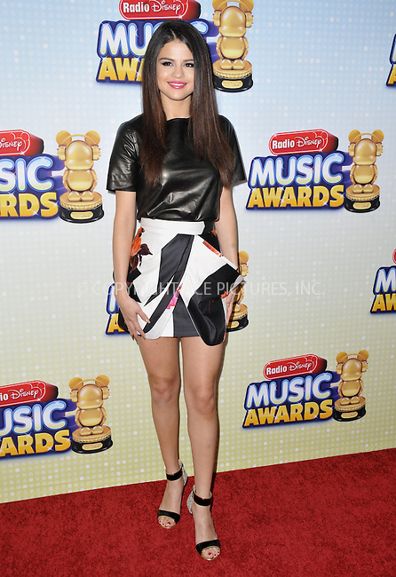 WWW.ACEPIXS.COM....April 27 2013, LA....Actress/singer Selena Gomez arriving at the 2013 Radio Disney Music Awards at the Nokia Theatre L.A. Live on April 27, 2013 in Los Angeles, California...........By Line: Peter West/ACE Pictures......ACE Pictures, Inc...tel: 646 769 0430..Email: info@acepixs.com..www.acepixs.com