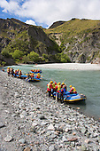 White water rafters prepare to launch on the Shotover River, Queenstown Lakes District, Otago, South Island, New Zealand.