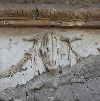 Skull of goat and garlands above the entrance to the Terme dei Sette Sapienti (Baths of the Seven Sages), 2nd century AD, Ostia Antica, Italy. Picture by Manuel Cohen