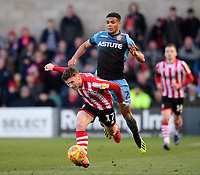 Lincoln City's Shay McCartan vies for possession with Stevenage's Luther Wildin<br /> <br /> Photographer Chris Vaughan/CameraSport<br /> <br /> The EFL Sky Bet League Two - Lincoln City v Stevenage - Saturday 16th February 2019 - Sincil Bank - Lincoln<br /> <br /> World Copyright © 2019 CameraSport. All rights reserved. 43 Linden Ave. Countesthorpe. Leicester. England. LE8 5PG - Tel: +44 (0) 116 277 4147 - admin@camerasport.com - www.camerasport.com