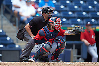 Columbus Clippers catcher Eric Haase (13) frames a pitch as home plate umpire Dan Merzel looks on during the game against the Durham Bulls at Durham Bulls Athletic Park on June 1, 2019 in Durham, North Carolina. The Bulls defeated the Clippers 11-5 in game one of a doubleheader. (Brian Westerholt/Four Seam Images)