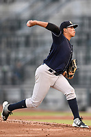 Starting pitcher Miguel Yajure (31) of the Charleston RiverDogs delivers a pitch during a game against the Columbia Fireflies on Tuesday, August 28, 2018, at Spirit Communications Park in Columbia, South Carolina. Columbia won, 11-2. (Tom Priddy/Four Seam Images)