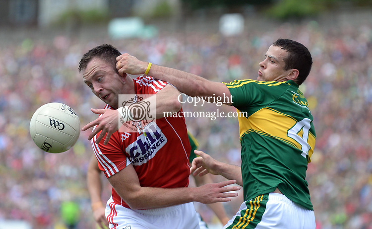 2-7-2017: Cork's Paul Kerrigan and Kerry's Shane Enright in action  at the Kerry V Cork Munster Football final in Killarney on Sunday.<br /> Photo: Don MacMonagle