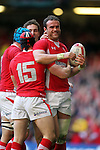 Welsh players celebrate with Jamie Roberts after scores the first try of the match for Wales..2012 RBS 6 Nations.Wales v Italy.Millennium Stadium..10.03.12.Credit: STEVE POPE-Sportingwales