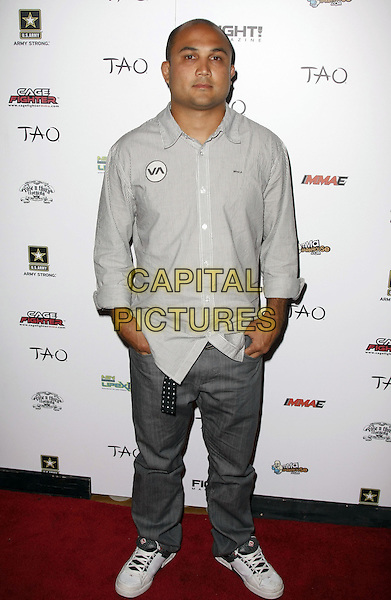 BJ PENN .Fight Magazine celebrates its 1st Year Anniversary at Tao Night Club inside the Venetian Hotel and Casino, Las Vegas, Nevada, USA, .05 July 2008.full length jeans trainers striped shirt.CAP/ADM/MJT.©MJT/Admedia/Capital Pictures