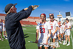 Los Angeles, CA 04/22/16 - An official conducts a pre-game stick check of Kylie Drexel (USC #23).