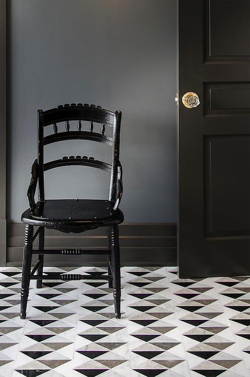 Arbus, a hand-cut stone mosaic, shown in polished Soccoro Grey, Nero Marquina, Carrara, and honed Cavern, is part of the Palazzo™ collection by New Ravenna.