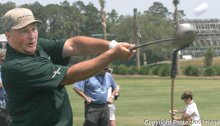 Gary Wilcox/Staff.... 05/06/07...Trick shot master Dan Boever tee's off a golf ball at the Players Championship annual free Youth Golf Clinic last  Saturday (05/05/07) at TPC Sawgrass Driving Range in Ponte Vedra Beach.