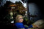 Liz Fenimore poses for a portrait on the couch she sleeps on at her daughter's home in Sacramento, Calif. January 17, 2011.