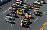 Apr 26, 2009; Talladega, AL, USA; NASCAR Sprint Cup Series driver Jimmie Johnson (48) and Denny Hamlin (11) race for the lead during the Aarons 499 at Talladega Superspeedway. Mandatory Credit: Mark J. Rebilas-