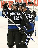 Andrew Gladiuk (Bentley - 12), Matt Blomquist (Bentley - 21) - The visiting Bentley University Falcons defeated the Northeastern University Huskies 3-2 on Friday, October 16, 2015, at Matthews Arena in Boston, Massachusetts.