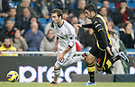 Real Madrid's Gonzalo Higuain against Real Zaragoza's Alvaro Gonzalez during La Liga Match. November 03, 2012. (ALTERPHOTOS/Alvaro Hernandez)