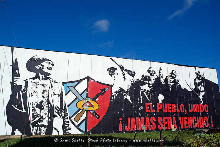 Political slogan on a billboard on a road side, Cuba.