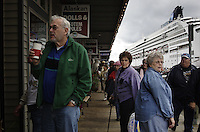 A many as six cruise ships a day can dock in Ketchikan during summer tourist season filling the streets with shoppers and sightseers for the afternoon.  Ketchikan which has a population of 17,000 can add numbers upwards of 9,000 people when several ships arrive.  Jewelry stores dominate the Front Street, most of which are owned by the cruise ships.  There are about 68 shops in town all vying for tourist dollars with diamonds and jewels,  Most close in the winter enabling their Pakistani workers to take business south.  Ketchikan was once a logging town but when the mill closed, it has turned to tourism.