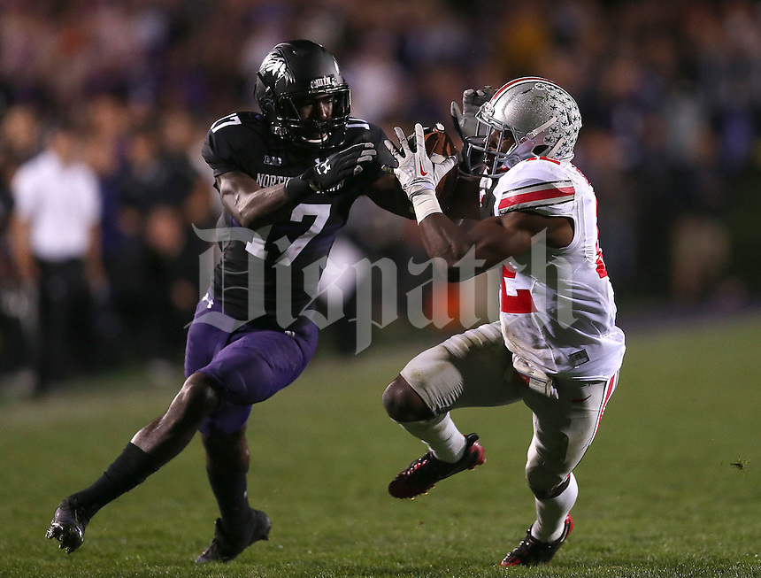 Ohio State Buckeyes cornerback Doran Grant (12) comes up with an interception against Northwestern Wildcats wide receiver Rashad Lawrence (17) during the second half of the NCAA football game between Ohio State and Northwestern at Ryan Field in Evanston, Illinois on Saturday, October 5, 2013. (Columbus Dispatch photo by Jonathan Quilter)