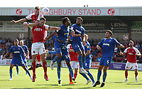 Fleetwood Town's Cian Bolger heads over team-mate Craig Morgan and Wimbledon's Andy Barcham and Tom Soares (right) <br /> <br /> Photographer Stephen White/CameraSport<br /> <br /> The EFL Sky Bet League One - Fleetwood Town v AFC Wimbledon - Saturday 4th August 2018 - Highbury Stadium - Fleetwood<br /> <br /> World Copyright &copy; 2018 CameraSport. All rights reserved. 43 Linden Ave. Countesthorpe. Leicester. England. LE8 5PG - Tel: +44 (0) 116 277 4147 - admin@camerasport.com - www.camerasport.com