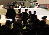 Casket containing the remains of one of the United States Embassy Bombing victims is carried off the transport that returned them to the US this morning during a Memorial Ceremony for those personnel killed in Africa in a hanger at Andrews Air Force Base in Maryland on August 13, 1998.<br /> Credit: Ron Sachs / CNP