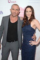 LOS ANGELES, CA - JUNE 25: Dominic Purcell and Sarah Wayne Callies at the together1heart launch party hosted by AnnaLynne McCord at Sofitel Hotel on June 25, 2016 in Los Angeles, California. Credit: David Edwards/MediaPunch