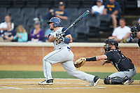 Ivan Gonzalez (32) of the West Virginia Mountaineers follows through on his swing against the Wake Forest Demon Deacons in Game Six of the Winston-Salem Regional in the 2017 College World Series at David F. Couch Ballpark on June 4, 2017 in Winston-Salem, North Carolina. The Demon Deacons defeated the Mountaineers 12-8. (Brian Westerholt/Four Seam Images)