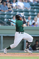 Outfielder Maikis De La Cruz (11) of the Savannah Sand Gnats bats in a game against the Greenville Drive on Wednesday, May 29, 2013, at Fluor Field at the West End in Greenville, South Carolina. Greenville won, 5-1. (Tom Priddy/Four Seam Images)