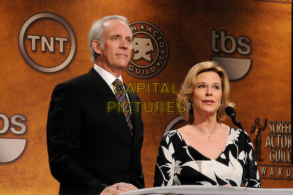 DARYL ANDERSONN & JOBETH WILLIAMS .17th Annual Screen Actors Guild Award Nominations held at The Pacific Design Center, West Hollywood, California, USA, 16th December 2010..half length black suit tie white print dress microphone .CAP/ADM/BP.©Byron Purvis/AdMedia/Capital Pictures.