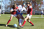24 November 2013: Duke's Kelly Cobb (9) is defended by Arkansas' Yvonne DesJarlais (15) and Margaret Power (28). The University of Arkansas Razorbacks played the Duke University Blue Devils at Koskinen Stadium in Durham, NC in a 2013 NCAA Division I Women's Soccer Tournament Third Round match. Duke advanced by winning the penalty kick shootout 5-3 after the game ended in a 2-2 tie after overtime.