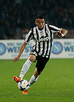 Mauricio Isla  in action during the Italian Serie A soccer match between SSC Napoli and Juventus FC   at San Paolo stadium in Naples, March 30 , 2014