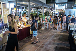 6 DECEMBER, 2019 BALI, INDONESIA:  Young tourists shopping at a Christmas market on Saturday night in Canggu, Bali. There has been a levelling out of Australian tourist numbers to Bali in recent times and tastes are changing regarding what people want from their holiday. Millennials are being targeted by tourism authorities and they want to give them more boutique experiences than just beach and beer. Picture by Graham Crouch/The Australian