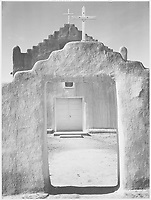 "Front view of entrance, ""Church, Taos Pueblo National Historic Landmark, New Mexico, 1942"" [Misicn de San Gercnimo] (vertical orientation);<br /> From the series Ansel Adams Photographs of National Parks and Monuments, compiled 1941 - 1942, documenting the period ca. 1933 - 1942."