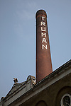 Chimney and building, former Truman brewery, Brick Lane, E1, London, England