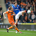 RANGERS' SASA PAPAC GETS TO THE BALL AHEAD OF DUNDEE UTD'S ROBBIE NEILSON
