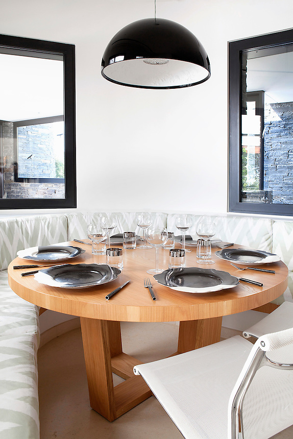 Contemporary dining area<br /> <br /> A residence in Athens, Greece designed by famed architect, Javier Barba.  The home is designed on the basis of &ldquo;green architecture&rdquo; integrating renewable resources and natural elements in it&rsquo;s design.