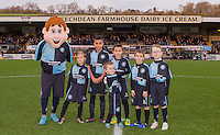 The Matchday mascots pose with 'Bodger' during the Sky Bet League 2 match between Wycombe Wanderers and Oxford United at Adams Park, High Wycombe, England on 19 December 2015. Photo by Andy Rowland.