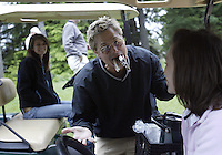 June 23, 2008:  Hollywood comedian Kato Kaelin has a little fun with the cart girl on hole #5 by placing all her cigars in his mouth while playing in the Detlef Schrempf celebrity golf classic held at McCormick Woods golf club in Port Orchard, WA.