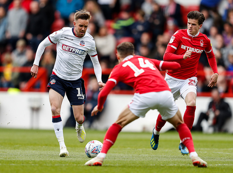 Bolton Wanderers' Craig Noone competing with Nottingham Forest's Matty Cash <br /> <br /> Photographer Andrew Kearns/CameraSport<br /> <br /> The EFL Sky Bet Championship - Nottingham Forest v Bolton Wanderers - Sunday 5th May 2019 - The City Ground - Nottingham<br /> <br /> World Copyright © 2019 CameraSport. All rights reserved. 43 Linden Ave. Countesthorpe. Leicester. England. LE8 5PG - Tel: +44 (0) 116 277 4147 - admin@camerasport.com - www.camerasport.com