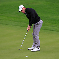 Romain Wattel (FRA) putts on the 1st green during Saturay's Round 3 of the 2014 BMW Masters held at Lake Malaren, Shanghai, China. 1st November 2014.<br /> Picture: Eoin Clarke www.golffile.ie