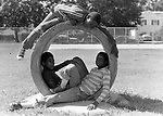 Children hanging out in a school playground in Carle Place, NY on a weekend. Photo by Jim Peppler.