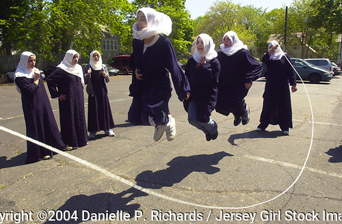 Students from the Al-Ghazaly Muslim School in New Jersey do a &quot;triple jump&quot;  during recess.  <br /> &copy; Danielle P. Richards / Jersey Girl Stock Images<br /> <br /> Keywords: Muslim, diversity, friendship, youth, jumping rope, melting pot, minorities, play, Arab, cultural awareness, exercise, school, fun, multicultural, recess, hijab