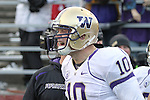 Jake Locker (#10), University of Washington quarterback, fires up his teammates as he comes out of the tunnel to warm up prior to the Huskies Pac-10 conference football game against arch-rival Washington State at Martin Stadium in Pullman, Washington, on December 4, 2010.  Washington scored a touchdown in the final minute of play in their annual Apple Cup battle to pull out a victory, 35-28.