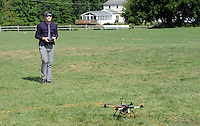Dan Myers, a music teacher at the school, controls the drone at Nativity of Our Lord school Monday September 21, 2015 in Warminster, Pennsylvania.   (Photo By William Thomas Cain)