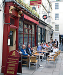 People sitting outside Coeur de Lion pub, Bath