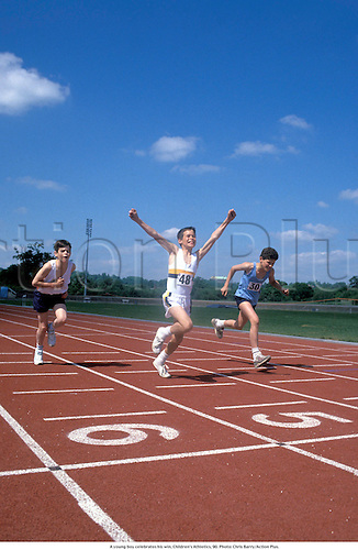 A young boy sprinter celebrates his win, Children's Athletics, 900. Photo: Chris Barry/Action Plus....1990.child children kids boy athlete.finish finishing line tape.boys Youngster Youngsters.celebrations celebration celebrate joy celebrating.win winner winners wins victor victory victories.success achievment.40MB