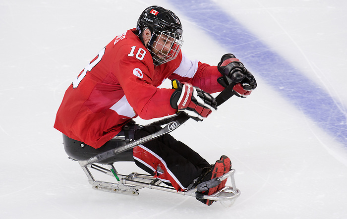Sochi, RUSSIA - Mar 13 2014 - Billy Bridges as Canada takes on USA in Sledge Hockey Semi-Final at the 2014 Paralympic Winter Games in Sochi, Russia.  (Photo: Matthew Murnaghan/Canadian Paralympic Committee)
