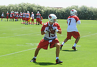 Jun 9, 2008; Tempe, AZ, USA; Arizona Cardinals quarterback (13) Kurt Warner and quarterback (7) Matt Leinart conduct throwing drills during mini camp at the Cardinals practice facility. Mandatory Credit: Mark J. Rebilas-