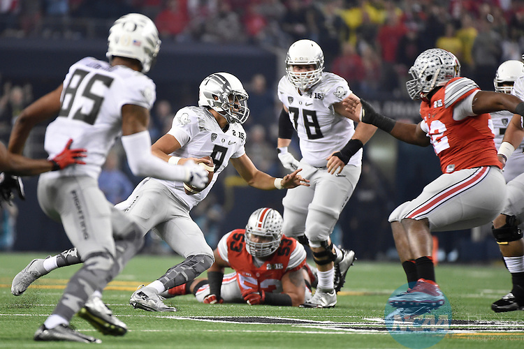 12 JAN 2015:  Marcus Mariota (8) of the University of Oregon scrambles against the Ohio State University during the College Football Playoff National Championship held at AT&T Stadium in Arlington, TX.  Ohio State defeated Oregon 42-20 for the national title.  Jamie Schwaberow/NCAA Photos