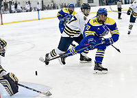 Delaware's Ethan Docking (32) scores a backhand goal during the second period. Delaware defeated Navy 8-3 at McMullen Hockey Arena.<br /> <br /> Photo by Randy Litzinger