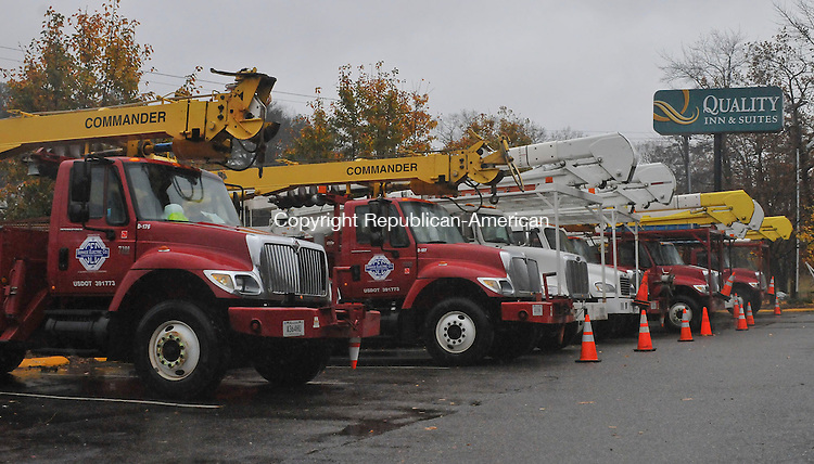 TORRINGTON, CT-29 OCTOBER 2012--102912JS02--Trucks from utility crews out of Tennessee sit in the parking lot of Quality Inn andSuites in Torrington on Monday in anticipation of damage from Hurricane Sandy. .Jim Shannon Republican-American