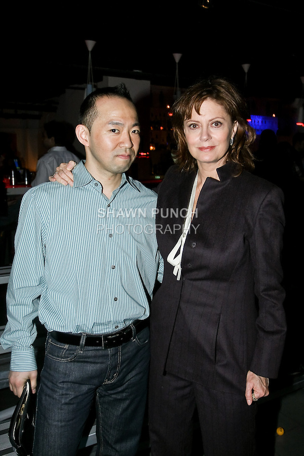 Actress Susan Sarandon and guest pose at Pre-NFL draft celebrity ping pong charity tournament, at Spin New York, April 19, 2010.